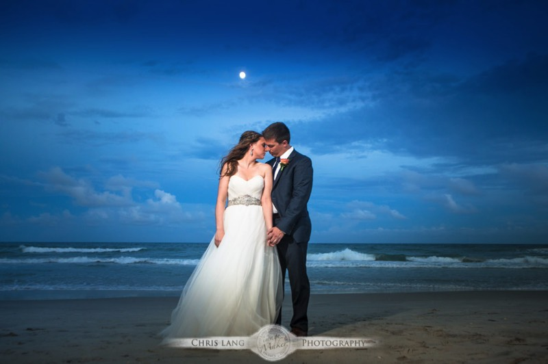 A wedding image of a bride and groom on the beach at Shell Island Resort enjoying the beach during sunset. Wilmingotn Wedding Photographer
